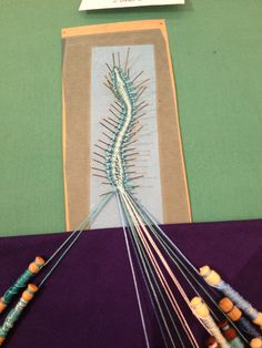 I had a play with making bobbin lace last week! A snake bookmark :)
