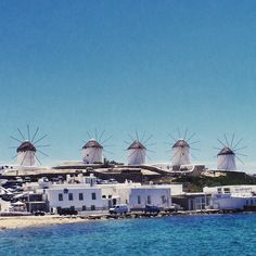 4 windmills on a hill in Mykonos, Greece.. #greece #mykonos #travel #holiday #beach #architecture #bluesky #MagicalGreece #windmills #WishYouWereHere