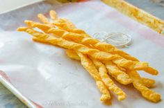 Puffed Cheddar Cheese Twists - an easy and perfect side for cocktails. #kitchenkapers #homemadehappyhour