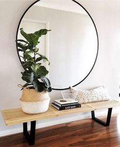 Minimal entryway decor with a large round mirror with gold frame - Decoist Decoration Hall, Decoration Entree, House Decorations, Home Interior, Interior And Exterior, Interior Decorating, Bohemian Interior, Interior Styling, Decorating Ideas