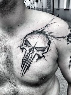 Guy With Sketched Punisher Skull Tattoo Design On Chest