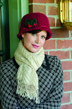 Easily knit this classic cloche hat, and then felt it to the perfect size. It is the ideal knitted accessory to keep you warm when caroling on cold winter nights, and the darling ribbon and lovely sprig of holly will inspire your holiday spirit.