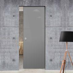 Eclisse 10mm Gloss Grey Colour Glass Syntesis Pocket Door - 7024.    #pocketglassdoor  #glassdoor  #framelessglassdoor Glass Pocket Doors, Glass Door, Grey Doors, Architrave, Bathroom Doors, Contemporary Style, Creative Design, Sconces, Wall Lights