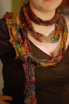 recycled sari silk yarn looks so cool in the skein, and is so hard to find a good pattern for... TheKnittingPhysicist came up with this approach, a skinny scarf with elongated garter stitches. Detail at click.