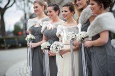 Winter Wedding Inspiration. How pretty are these dresses and faux fur stoles?