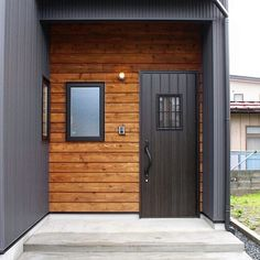 I want clear tongue and groove red cedar but I like the idea of a black door with the rest of the house white board and batten Exterior House Colors, Exterior Design, Interior And Exterior, Storage Container Homes, Home Porch, Basement House, Exterior Cladding, Entrance Doors, Loft