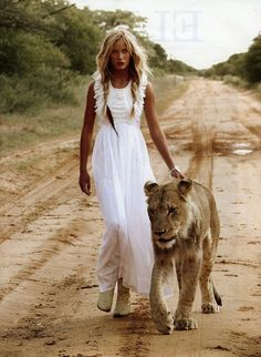 Reminds me of Africa - I love that place!  Just wish I could manage to keep a white outfit the same fresh white color while on a dirt road next to a lion  ;)                         Elle Norway #lion