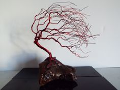 Burgundy Wire Tree Sculpture on driftwood by Nannerbfree on Etsy https://www.etsy.com/listing/265332325/burgundy-wire-tree-sculpture-on