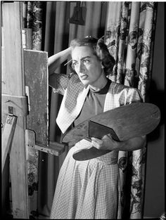 Joan Crawford paints, photo by Stanley Kubrick, 1948