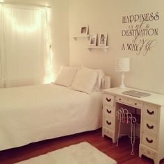 Fairy lights and a personal quote in vinyl can brighten up a simple white room. #anthropologie #pintowin
