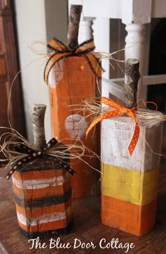 """New from The Blue Door Cottage... this cute set of Rustic Wood """"Candy Corn"""" Pumpkins is perfect for a touch of Halloween Whimsy. 12""""-8""""-6"""".  Comes with raffia and ribbons. $24/set  + shipping  https://www.facebook.com/permalink.php?story_fbid=869208959757832&id=855577674454294"""
