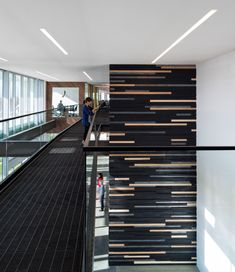 A Creative Office Space for a Creative   Encasing the central elevators, an ancient Japanese technique of burning wood was applied to some of the planks attached horizontally. For the pattern, they mixed burned oak and unburned hickory from a strict template provided to the installers.