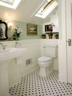 Bathroom with Mint Walls & black and white tile floors. #skylight #attic #powderroom
