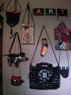 Purse wall. Fun idea for the blank wall in my bedroom!