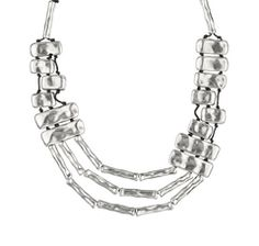 Silvered necklace, by Spanish jewellery brand Uno de 50