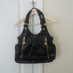 """HP ✨ B. Makowsky Black Embossed Leather Bag Exterior features: embossed leather, gold hardware (minimal scratches and two tarnished pieces), double shoulder strap, two zip side pockets, top magnetic closure, back slip pocket. Interior features: signature leopard print lining with center zipper divider, back zip pocket, two slip pockets. Excellent condition (no tears, rips, or stains). Body/trim 100% genuine leather; lining 100% polyester. Comes with original dust bag. Approximately: 13""""W x…"""