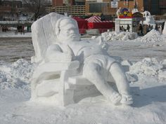 Santa finally getting a chance to relax. Made out of snow....so cute !  Photo via web