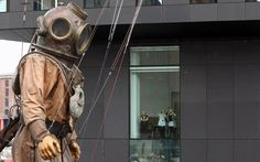 IMAGES OF A GIANT DEEP SEA DIVER | office workers watch as a giant deep sea diver the uncle of the little ...