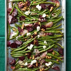 Roasted green beans topped with feta cheese, beets, and walnuts. More side dishes: http://www.bhg.com/recipes/entertaining/dinner/squash-potatoes-and-carrots-as-side-dishes/?socsrc=bhgpin110112roastedgreenbeans#page=9