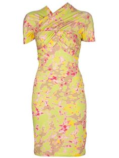 yellow cotton blend dress from carven featuring a high neckline, a wrapover effect at the top. a runched detail at the bust, short sleeves with runched detail, gathering at the back and an all over floral print