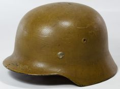 Lot 352: World War II German Army Infantry Helmet; Attached leather lining; numbered on the inside of the helmet and the leather lining