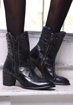 Wear these handmade black leather heeled boots by BEDSTU with tights and your favorite sweater this season.