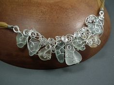 white-ish beach glass with silver necklace
