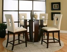 "Cramco Emerson 5 piece Counter Height Dining Set by Cramco. $890.00. Modern Style. Counter Height Dining Set. This item ships common carrier.. Color: Dark Cherry/Ivory Vinyl. Size: 48""H x 48""W x 36""D. Experience elevated dining with your next dining room set, the Emerson 5 Piece Counter Height Dining Set comes with a beautiful glass table top and an elongated wooden base to complete this dining room set. The Emerson 5 Piece Counter Height Dining Set serves a d..."