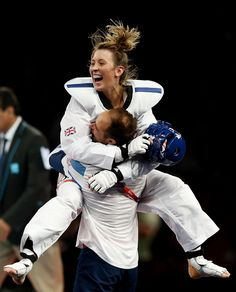 Day thirteen: Jade Jones of Team GB and her coach celebrate Jones defeating Yuzhuo Hou of China during the Women's -57kg Taekwondo gold medal final.