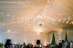 Ceiling draping-the look with the garland (could be in brown) and lights.