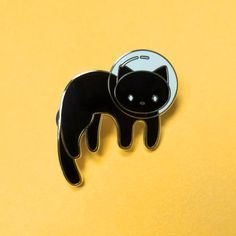 Kitty has a mission to attend to in space. Pin by Meugraphics. 1.5 inches. Hard enamel with gold plating.