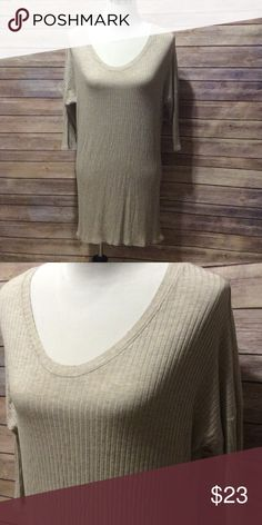 Oatmeal tunic Ribbed oatmeal colored tunic. Can also be worn as a short dress. Very forgiving. Knit. Size medium but can fit a large. Elbow length sleeves. Tops