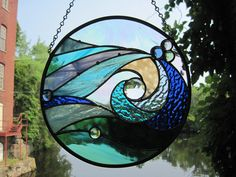 Ocean Wave Stained Glass Round Panel. $150.00, via Etsy. I would love this out my kitchen window....