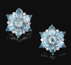 A PAIR OF AQUAMARINE AND DIAMOND EAR CLIPS, CARTIER  One pair of ear clips set with pear-shaped and circular-cut aquamarines, circular- and brilliant-cut diamonds, mounted in platinum, all signed Cartier London and numbered,