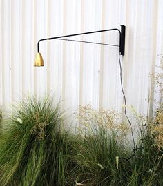 Brass wall-mounted swing lamp - looks perfect for beside.