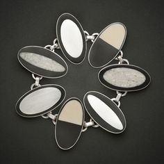 """Carla Pennie McBride: , Bracelet in sterling silver, fossilized ivory, and resin. Each oval is approx. 0.75 x 1.5"""""""