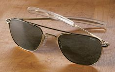 """Acquire turns us on to this pair of aviators by Randolph Engineering for Orvis. """"For decades, Randolph Engineering's aviator sunglasses have been standard issue for US military pilots and NASA astronauts."""" The lenses area tint of green/grey while the frame is in a classic gold finish with a straight temple/earpieces to keep it snug, Goose."""