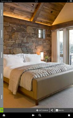 Sophisticated rustic bedroom. Obsessed with stone and old beams crossed with soft colors and drywal