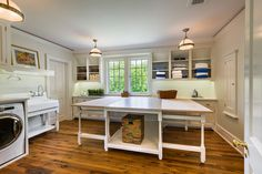Plenty of room to sew with large center table and shelving ~ http://www.PZArchitects.com  ~ Click through to Houzz for a stunning large photo ~