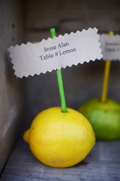Lemon and lime escort card holders. Don't know what we need these for yet but love it - maybe food station or margarita station signs..