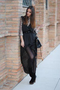 Black asymmetrical skirt with snakeskin shirt