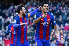 Luis Suarez of FC Barcelona celebrates with his team mate Lionel Messi after scoring his team's first goal during the La Liga match between FC Barcelona and UD Las Palmas at Camp Nou stadium on January 14, 2017 in Barcelona, Catalonia.