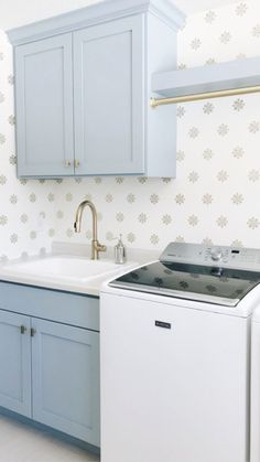Bria Hammel Interiors - Laundry Room with Pale Grey Cabinets. A stylish and mode. Bria Hammel Interiors – Laundry Room with Pale Grey Cabinets. A stylish and modern laundry room t Blue Laundry Rooms, Modern Laundry Rooms, Small Laundry, Laundry Room Cabinets, Laundry Room Organization, Grey Cabinets, Laundry Storage, Basement Laundry, Laundry Shelves