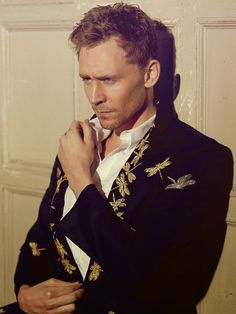 Tom Hiddleston is one of the few men alive who could actually look drop-dead gorgeous in a jacket embroidered with dragonflies.