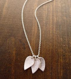 Silver Leaf Cluster Necklace | Add a little natural pizazz to your outfit with this sleek ste... | Necklaces
