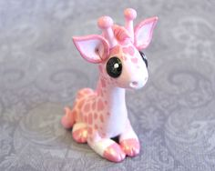 Give your special someone a truly unique valentines gift this year! This sweet little giraffe is made of high quality polymer clay, with a hand-painted pattern with hearts worked into it. She is coated in a protective glossy varnish and stands about 1.5 inches tall. $30.00