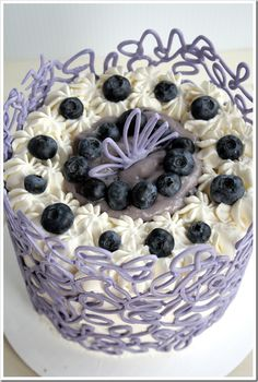 How To: Chocolate Cage Tutorial {lemon cake filled with blueberry whipped cream and iced it with sweetened whipped cream. For the cage, tinted white chocolate}