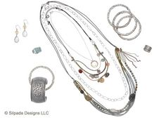 Transport yourself to another time and place with the old-world glamour in this collection of Sterling Silver, Smoky Quartz, Pyrite and Brass.