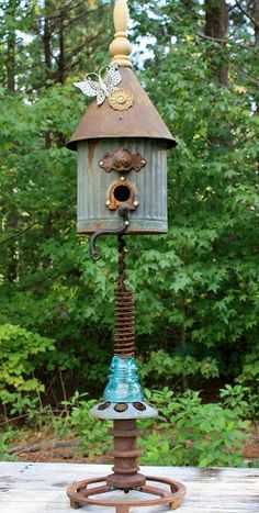 """*The Brambleberry Cottage*: Sweet """"Tweet"""" Retreat. Found Object Bird House   This cool birdhouse was from a rusty funnel, an oil can, an insulator and spring, etc. Her husband welded it together from bits and pieces that were cluttering her barn."""