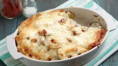 Get this all-star, easy-to-follow Scalloped Potatoes and Ham recipe from Ree Drummond, serves twelve